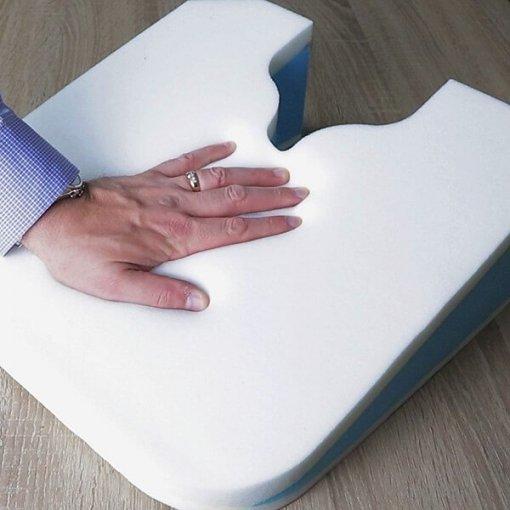 Hand pressing on Sit and Sigh ORIGINAL cushion