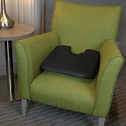 Sit and Sigh ORIGINAL cushion on green lounge chair